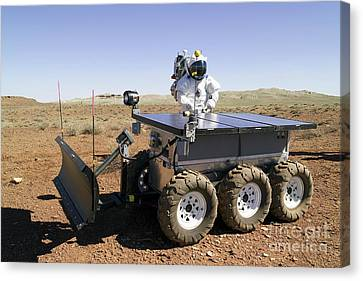 An Astronaut Drives An Electric Tractor Canvas Print by Stocktrek Images