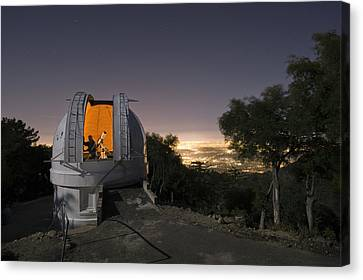 An Astronomer Works Inside A Dome Canvas Print by Jim Richardson