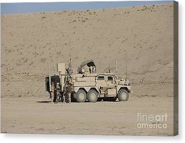 An Eod Cougar Mrap In A Wadi Canvas Print by Terry Moore