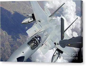 An F-15 Eagle Pulls Away From A Kc-135 Canvas Print by Stocktrek Images