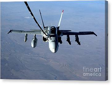 An Fa-18c Hornet Receives Fuel Canvas Print by Stocktrek Images