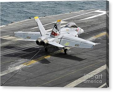 An Fa-18f Super Hornet Traps An Canvas Print by Stocktrek Images