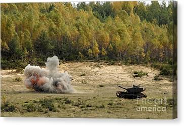 An M60 Patton Tank Explodes Canvas Print by Stocktrek Images