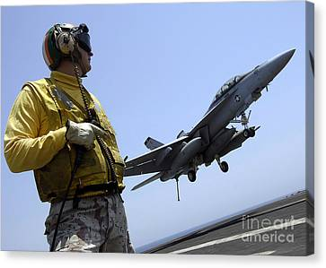 An Officer Observes An Fa-18f Super Canvas Print by Stocktrek Images