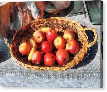 Apples And Bananas In Basket Canvas Print by Susan Savad