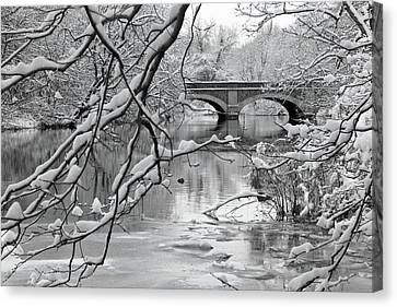 Arch Bridge Over Frozen River In Winter Canvas Print by Enzo Figueres