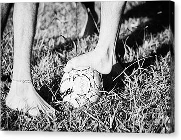 Argentinian Hispanic Men Start A Football Game Barefoot In The Park On Grass Canvas Print by Joe Fox