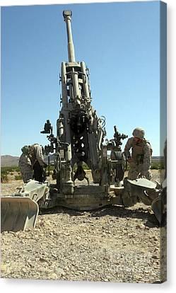 Artillerymen Manning The M777 Canvas Print by Stocktrek Images