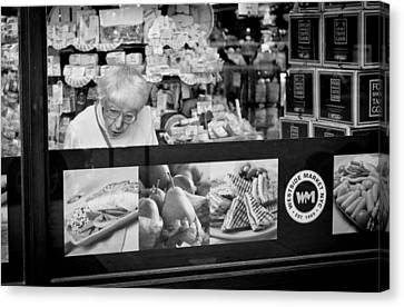 At The Deli Canvas Print by Michael Avory
