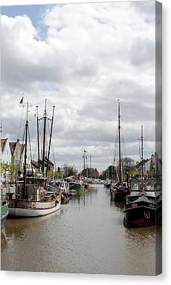 At The Old Harbor Canvas Print by Steve K