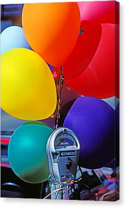 Balloons Tied To Parking Meter Canvas Print by Garry Gay
