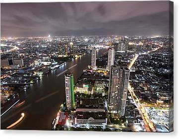 Bangkok City At Twilight  Canvas Print by Anek Suwannaphoom