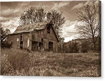 Barn In Turbulent Sky Canvas Print by Douglas Barnett
