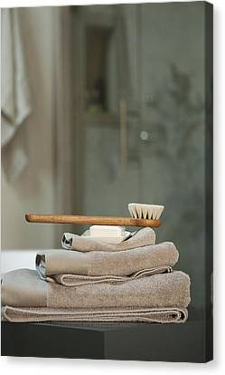 Bath Brush On Stacked Towels Canvas Print by Karyn R. Millet