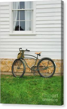 Bicycle By House Canvas Print by Jill Battaglia