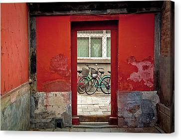 Bicycles In Red Doorway Canvas Print by photo by Sharon Drummond