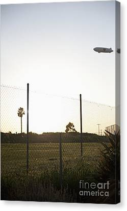 Blimp Flying Over Sports Field Canvas Print by Sam Bloomberg-rissman
