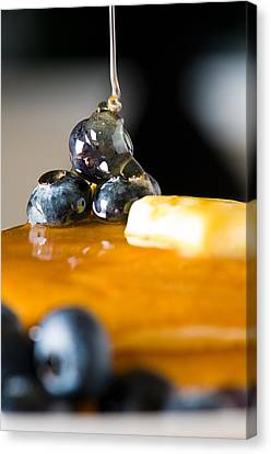 Blueberry Butter Pancake With Honey Maple Sirup Flowing Down Canvas Print by Ulrich Schade