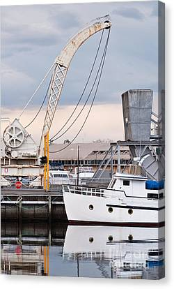 Boat And Old Crane Reflections Canvas Print by David Lade