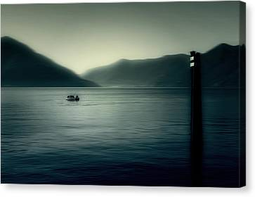 boat on the Lake Maggiore Canvas Print by Joana Kruse