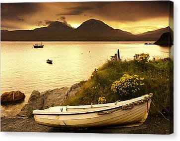 Boat On The Shore At Sunset, Island Of Canvas Print by John Short