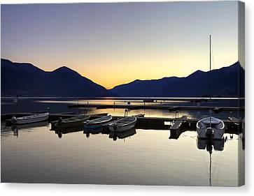 Boats In The Sunset Canvas Print by Joana Kruse