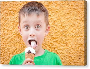 Boy Having Ice Cream Canvas Print by Tom Gowanlock