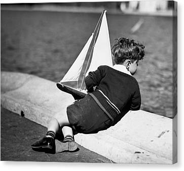 Boy Playing With Toy Sailboat Canvas Print by George Marks