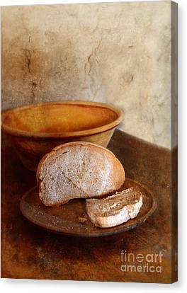 Bread On Rustic Plate And Table Canvas Print by Jill Battaglia