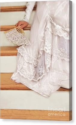 Bride Sitting On Stairs With Lace Fan Canvas Print by Jill Battaglia