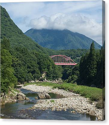 Bridge Over Lush River Gorge In Mountains Canvas Print by Ippei Naoi