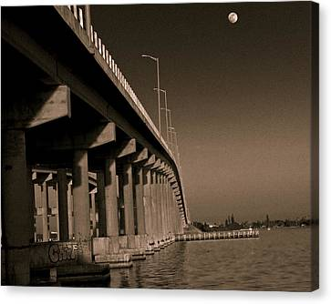 Bridge To The Moon Canvas Print by Roger Wedegis