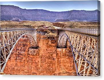 Bridges At Lees Ferry Canvas Print by Jon Berghoff
