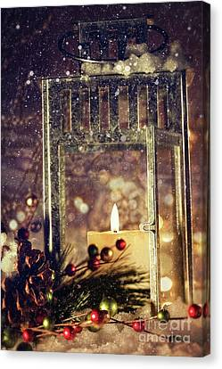 Brightly Lit Lantern In The Snow Canvas Print by Sandra Cunningham