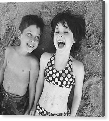 Brother And Sister On Beach Canvas Print by Michelle Quance