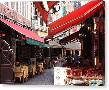 Brussels Restaurant Street - Rue De Bouchers Canvas Print by Carol Groenen
