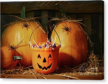 Bucket Filled With Halloween Candy Canvas Print by Sandra Cunningham