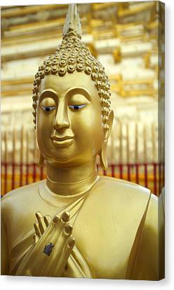 Buddha Figure At Wat Doi Suthep Canvas Print by Toby Williams
