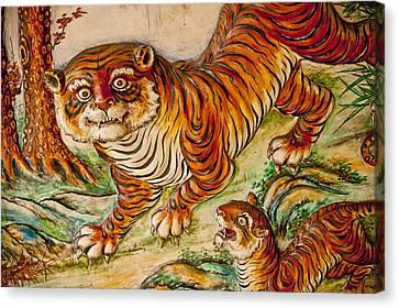 Buddhist Temple Decorations In Canvas Print by Rowan Gillson