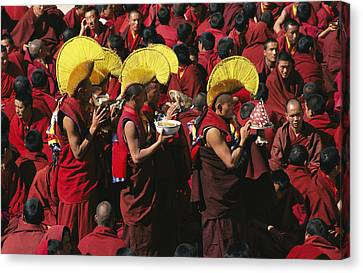 Buddist Monks At Nechung Monastery Canvas Print by Maria Stenzel