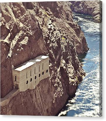Building Built Into River Valley Cliff Canvas Print by Eddy Joaquim