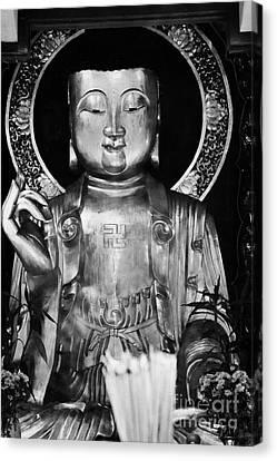 Burning Incense In A Buddhist Temple Sha Tin Hong Kong China Canvas Print by Joe Fox