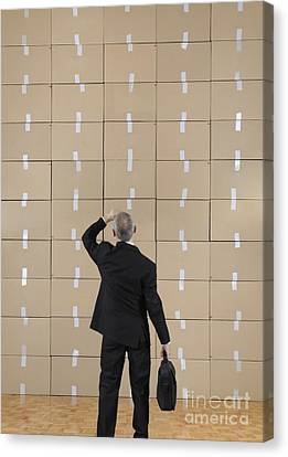 Businessman Facing A Cardboard Boxes Wall Canvas Print by Sami Sarkis