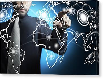 Businessman Touching World Map Screen Canvas Print by Setsiri Silapasuwanchai