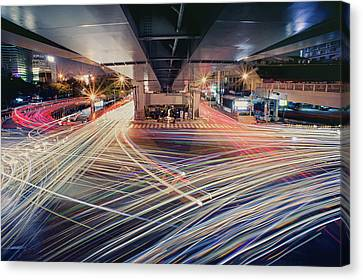 Busy Light Trail In City At Night Canvas Print by Yiu Yu Hoi