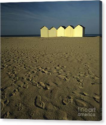 Cabins On A Beach In Normandy Canvas Print by Bernard Jaubert
