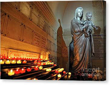 Candles And Virgin Mary With Infant Canvas Print by Sami Sarkis