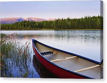 Canoe And Boya Lake At Sunset, Boya Canvas Print by Yves Marcoux