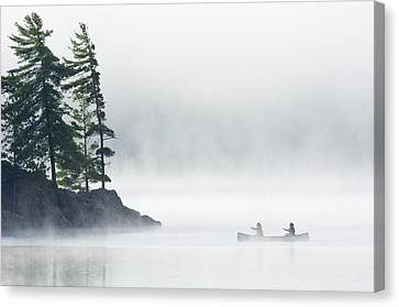 Canoeing Through Fog On Lake Of Two Canvas Print by Mike Grandmailson