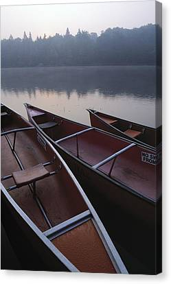 Canoes On Still Water Canvas Print by Natural Selection John Reddy